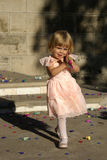 Child playing. A child playing with confetti in sunset Stock Photos