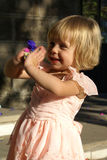 Child playing. A child playing with confetti in sunset Royalty Free Stock Photos