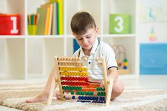 Child playing with abacus Stock Image