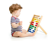 Child playing with abacus toy. Concept of early Royalty Free Stock Photos