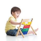 Child playing with abacus toy Stock Photography