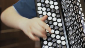 Child playing the accordion. close-up stock footage
