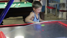 Child playing air hockey, joy and emotion, 1080p