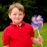 Child playing with American flag pinwheel Stock Image