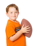 Child playing with American football Stock Image