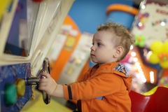 Child playing with amusement machine Stock Photos