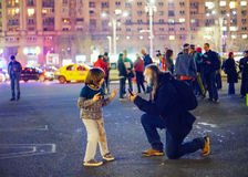 Child playing at anti corruption protests, Bucharest, Romania Stock Image