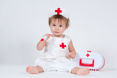 Child playing as a doctor with syringe Royalty Free Stock Photo