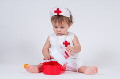 Child playing as a doctor with syringe stock photos