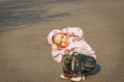 Child playing on the asphalt Stock Photography
