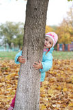 Child playing in autumn Stock Photography
