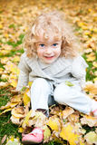 Child playing in autumn park Stock Photo