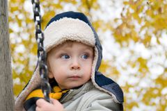 Child playing in autumn park Stock Images