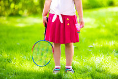 Child playing badminton or tennis outdoor in summer Royalty Free Stock Photo