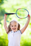 Child playing badminton or tennis outdoor in summer Royalty Free Stock Image