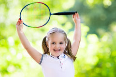 Child playing badminton or tennis outdoor in summer Stock Image