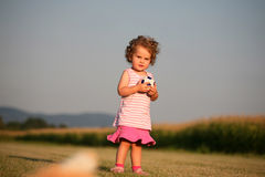 Child playing with ball Stock Photos