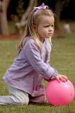 Child playing with ball stock image