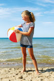 A child playing with a ball on the beach. Royalty Free Stock Photography