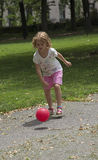 Child playing ball in a park Royalty Free Stock Photography