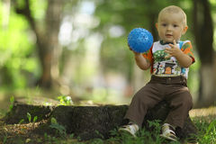 Child playing with ball in  park Stock Image