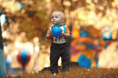 Child playing with ball in  park Stock Photo