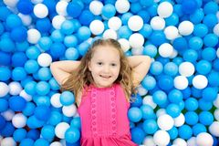 Kids play in ball pit. Child playing in balls pool royalty free stock photos