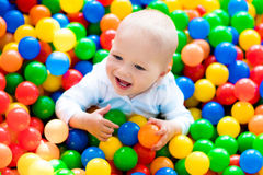 Child playing in ball pit on indoor playground Stock Images