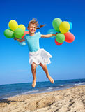 Child playing with balloons at the beach Royalty Free Stock Photos