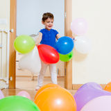 Child playing with  balloons Royalty Free Stock Photo