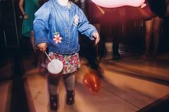 Child playing with balloons at party disco at wedding ceremony r. Eception stock photo