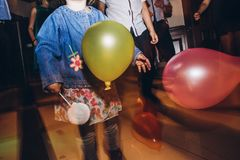 Child playing with balloons at party disco at wedding ceremony r. Eception stock photography