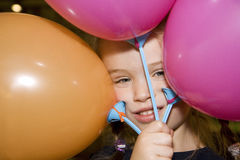 Child playing with balloons stock images