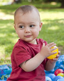 Child playing with balls royalty free stock photography