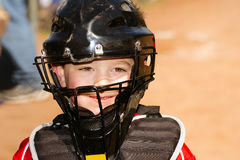 Child playing baseball. Portrait of child with catcher s equipment on during baseball game Royalty Free Stock Image