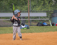 Child Playing Baseball. Young boy at bat in a little league game Royalty Free Stock Photos
