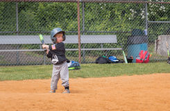 Child Playing Baseball. Young boy beginning his swing Royalty Free Stock Photo