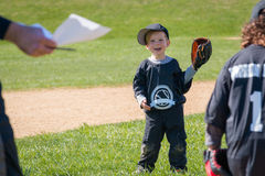 Child Playing Baseball. Young boy with glove having fun playing baseball Stock Photos