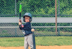 Child Playing Baseball. Young boy standing in the batters box waiting for the pitch Stock Photography