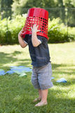 Child playing with basket in garden Royalty Free Stock Photography