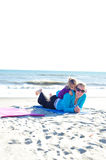 Child playing at the beach. Child and mother playing at the beach Royalty Free Stock Image