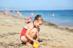 Child playing on the beach Stock Photos