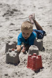 Child playing on the beach. royalty free stock image