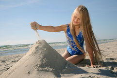 Child playing on beach Royalty Free Stock Image
