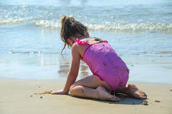 Child playing on the beach. With the sand royalty free stock photography