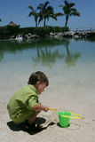 Child playing on beach. Young boy playing on beach with bucket and spade Stock Image