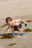Child playing on beach Stock Images