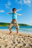 Child playing on the beach Royalty Free Stock Photo