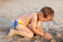 Child playing on the beach stock photography