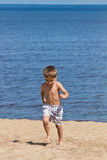 Child playing on the beach Royalty Free Stock Photos